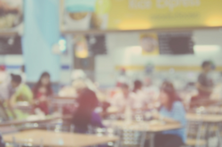 food court: Blur people eating in food court abstract background. Stock Photo
