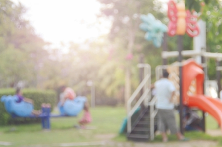on playground: Blur playground in nature park abstract background. Stock Photo
