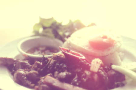 fired egg: Blur Moo Pad Kee Mao and fired egg, Traditional Thailand Food abstract background.Retro color style.