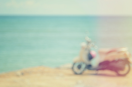 Blur motorcycle on sunset beach abstract background.Travel concept.Vintage color style. Stock Photo