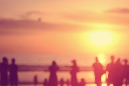 persone relax: Blur people relax on tropical sunset beach abstract background.Travel concept.Retro color style.