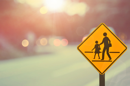 sign post: School sign.Traffic sign road on blur road abstract background.Retro color style.
