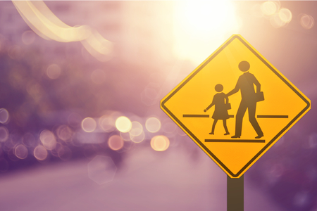 child education: School sign.Traffic sign road on blur road abstract background.Retro color style.