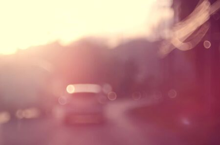 time drive: Blur traffic bokeh road abstract background.Retro color style. Stock Photo