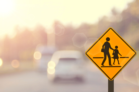 traffic: School sign.Traffic sign road on blur road abstract background.