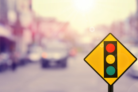 Traffic light sign on blur road background.Retro color style.
