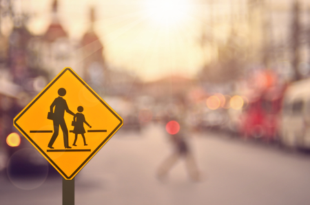 School sign on blur traffic road background.Retro color style. Zdjęcie Seryjne