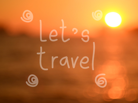 let s: Let s travel word hand writing on blur tropical sunset beach abstract background.Travel concept.