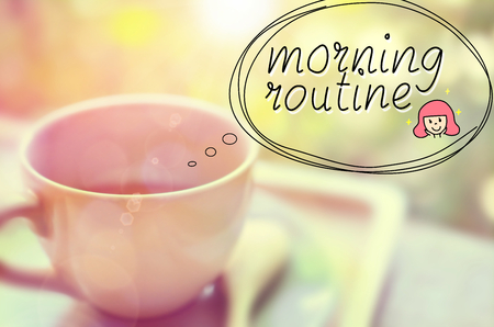 morning routine: Morning routine words hand writting on blur a cup of coffee.Retro color style. Stock Photo