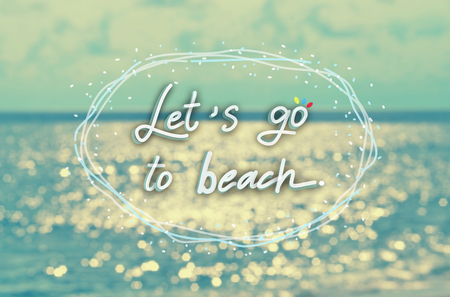 let s: Let s go to beach words hand writing on blur tropical sunset beach abstract background.Travel concept.