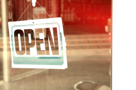 open sign: Open sign hanging on glass door in cafe. Retro color style. Stock Photo