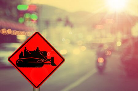 tractor sign: Traffic sign,construction tractor sign on blur traffic road abstract background.Retro color style. Stock Photo