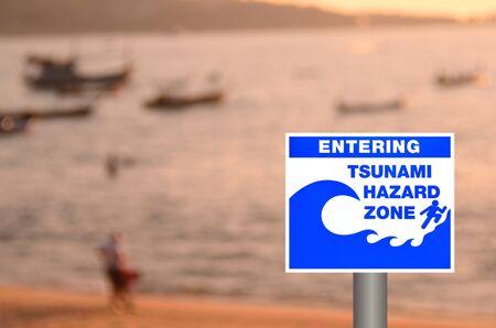 quake: Tsunami sign on blur sunset beach background. Stock Photo