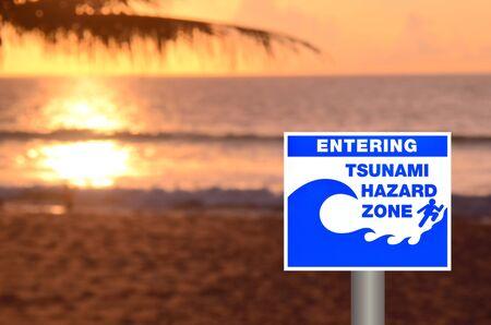 tsunami: Tsunami sign on blur sunset beach background. Stock Photo
