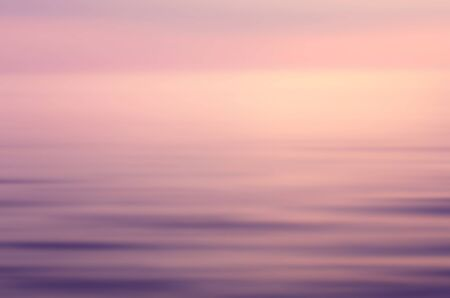 Motion blur tropical sunset beach and smooth wave. Travel concept. Retro color style.