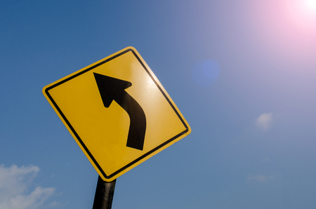 curve: curve road sign on blue sky background.