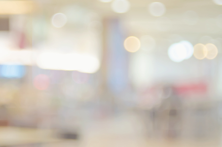 center court: Blur people at food court in shopping center mall abstract background. Retro color style. Stock Photo