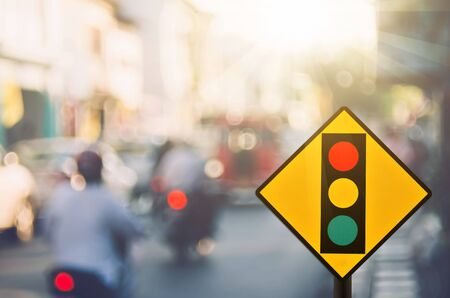 Traffic sign,traffic light sign on blur traffic road abstract background.Retro color style.
