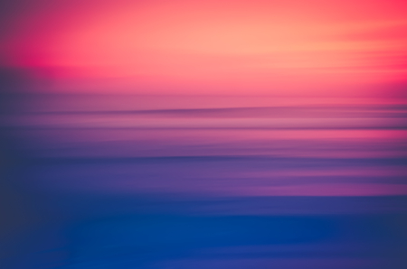 Motion blur colorful tropical sunset beach and smooth wave. Travel concept.
