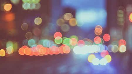 street lamp: Abstract colorful bokeh light on traffic road in city night background. Vintage tone color. Stock Photo