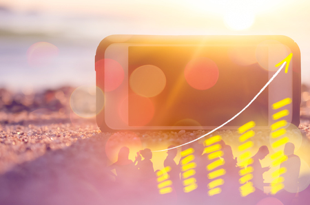 flèche double: Business economic technology freedom trader working concept. Smart phone on sand sunset beach double exposure graph money stock trading up trend arrow bar bokeh people background. Vintage filter color