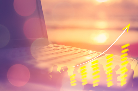 Business economic technology working concept. Keyboard notebook on tropical sunset beach double exposure graph bar money stock trading up trend arrow bokeh people background.Vintage filter effect color Stock Photo