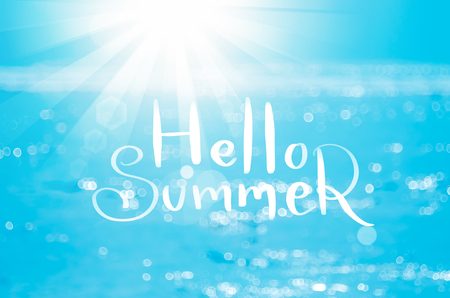 Hello summer words on blur tropical beach with bokeh sun light wave abstract background. Copy space of outdoor summer vacation and travel adventure concept. Vintage tone filter effect color style.