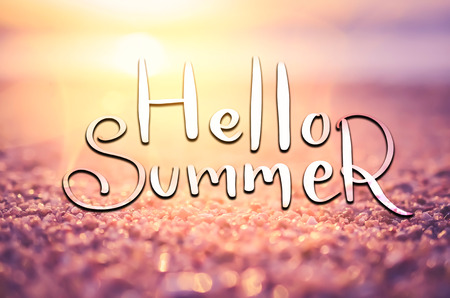 Hello summer words on blur tropical sunset beach with bokeh sun light wave abstract background. Copy space of outdoor summer vacation and travel adventure concept. Vintage tone filter effect color style. Imagens