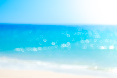 Summer vacation outdoor and travel holiday adventure concept.Copy space blur tropical beach with bokeh sun light wave on blue sky and white cloud abstract background. Vintage tone filter effect color. 写真素材