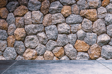 Dark room stone brick wall texture background. Copy space for product presentation and graphic design. Stockfoto - 122869205