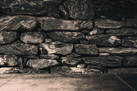 Dark room stone brick wall texture background. Copy space for product presentation and graphic design. Stockfoto - 122869215