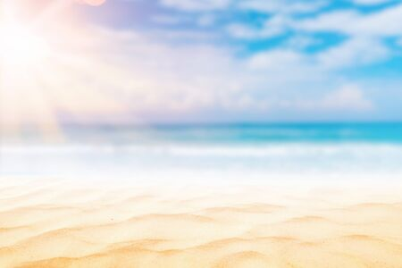 Summer vacation outdoor and travel holiday adventure concept.Copy space blur tropical beach with bokeh sun light wave on blue sky and white cloud abstract background. Vintage tone filter effect color. Banco de Imagens