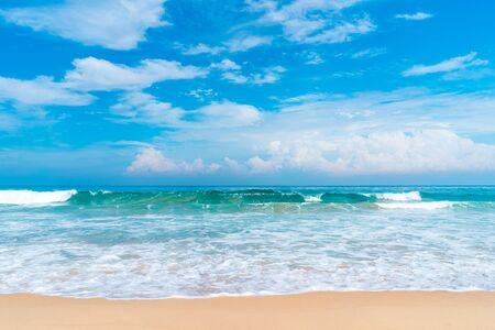 Beautiful tropical beach with blue sky and white clouds abstract texture background. Copy space of summer vacation and holiday business travel concept. Vintage tone filter effect color style. Banco de Imagens