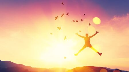 Happy man jumping on top of mountain and sunset sky star with birds fly abstract background. Copy space freedom travel adventure and business victory concept. Vintage tone filter effect color.
