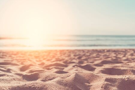Copy space of soft sand sea and blur tropical beach with sunset sky and cloud abstract background. Summer vacation adventure and holiday travel freedom concept. Vintage tone filter effect color style.