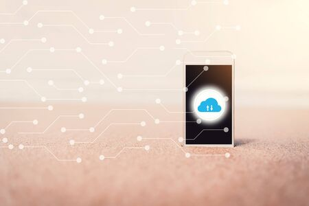 Smart phone on tropical sunset beach with cloud icon and line dot abstract background. Technology business and travel nature concept. Vintage tone filter effect color style.