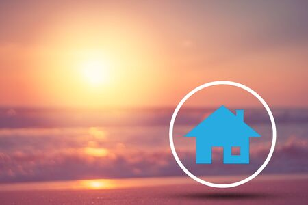 Copy space of blur tropical beach and bokeh sun light wave with home icon abstract background. Summer vacation adventure and holiday travel freedom concept. Vintage tone filter effect color style. 스톡 콘텐츠