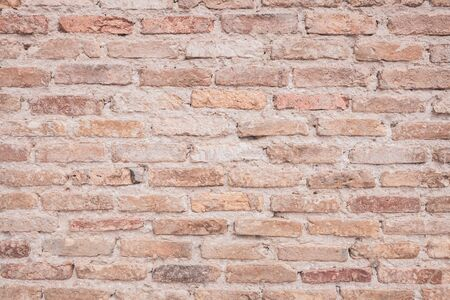 Old grunge brown stone brick wall texture abstract background. Copy space of horizontal architecture backdrop wallpaper.