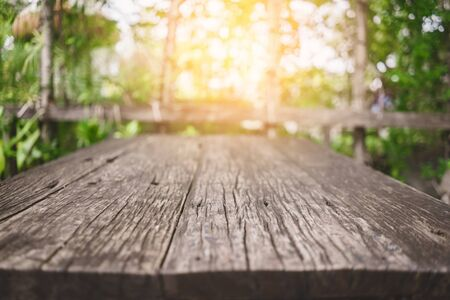 Blur park and green nature bokeh leaf  with sun light on copy space empty old wood table abstract background. Product presentation in fresh nature. Ecology environment and nature concept. 스톡 콘텐츠
