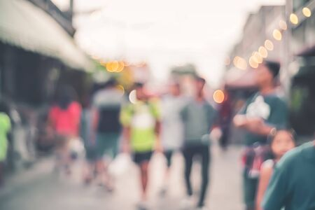 Blur people at local street market with colorful bokeh light abstract background. Copy space of business retail and travel vacation concept. Vintage tone filter effect color style. 스톡 콘텐츠