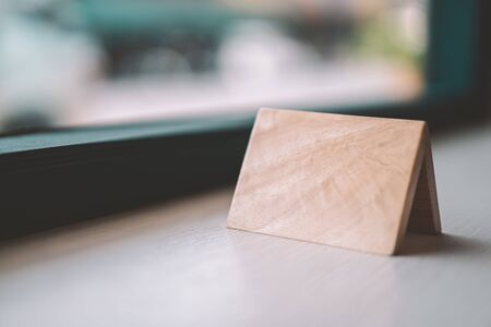 Empty small wooden on table in coffee shop. Vintage tone color style.