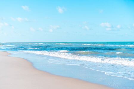 Beautiful tropical beach with blue sky and white clouds abstract texture background. Copy space of summer vacation and holiday business travel concept. Vintage tone filter effect color style. 免版税图像
