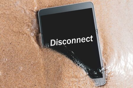 Disconnect words on smart phone at tropical sand beach texture background. Technology business and travel nature concept.