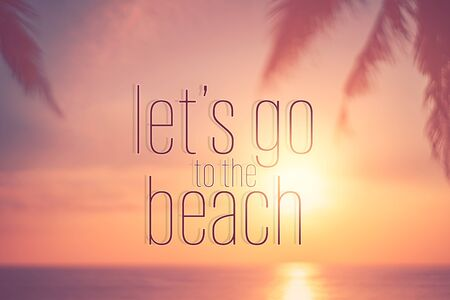 Let's go to the beach words on blur tropical sunset beach with bokeh sunlight wave abstract background. Summer vacation and travel holiday concept. Vintage tone filter effect color style.