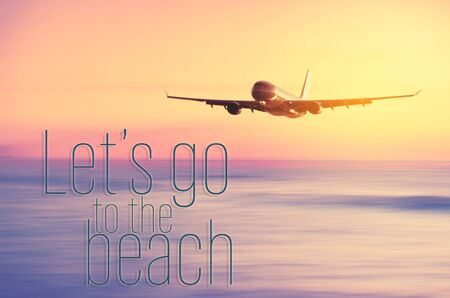 Airplane flying with let's go to the beach words over blur tropical beach and sunset sky abstract background. Copy space of business summer vacation and travel adventure concept. Vintage tone color. 免版税图像
