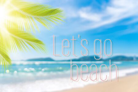 Let's go beach words on blur tropical beach with bokeh sunlight wave abstract background. Summer vacation and travel holiday concept. Vintage tone filter effect color style.