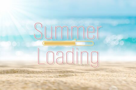 Summer loading words on blur tropical beach with bokeh sunlight wave abstract background. Summer vacation and travel holiday concept. Vintage tone filter effect color style.