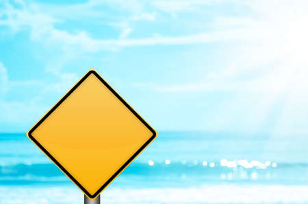 Empty yellow sign on blur tropical beach bokeh sun light wave abstract background. Copy space summer vacation and business travel concept. Vintage tone filter color style.