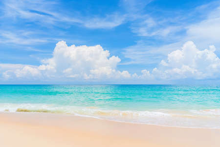 Beautiful tropical beach with blue sky and white clouds abstract texture background. Copy space of summer vacation and holiday business travel concept. Vintage tone filter effect color style. Stock Photo