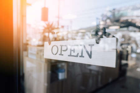 Open sign hanging front of cafe with colorful bokeh light abstract background. Business service and food concept. Vintage tone filter effect color style. Standard-Bild